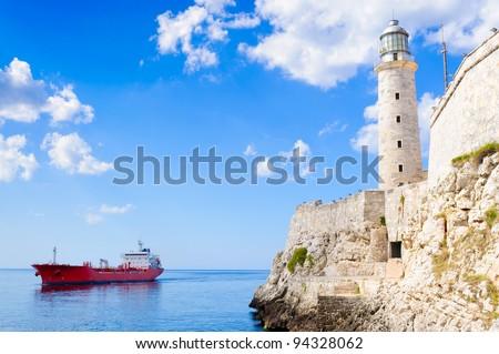 El Morro castle in Havana with a commercial ship on a calm caribbean sea - stock photo