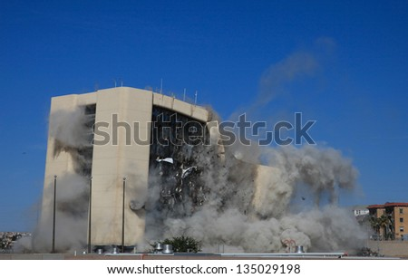 EL PASO, TEXAS â?? APRIL 14:  City Hall was imploded on Sunday morning before a large crowd, making way for the new AAA baseball stadium on April 14, 2013 in El Paso, Texas. - stock photo