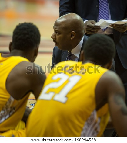 EL PASO, TEXAS -Â?Â? DECEMBER 28.  Alcorn State Head Coach Luther Riley talks to the team during a time out  in the Invitational Tournament on December 28, 2013 in El Paso, Texas.    - stock photo