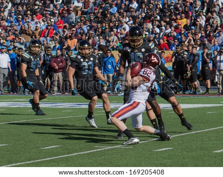 EL PASO, TEXAS - DECEMBER 31.  Virginia Tech�s Willie Byrn (82) with a fair catch at the Sun Bowl on December 31, 2013 in El Paso, Texas.    - stock photo