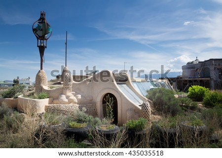 El PRADO, NM, USA-  MAY 30, 2016: Unusual house built of bottles, tires and concrete. Earthship Biotecture