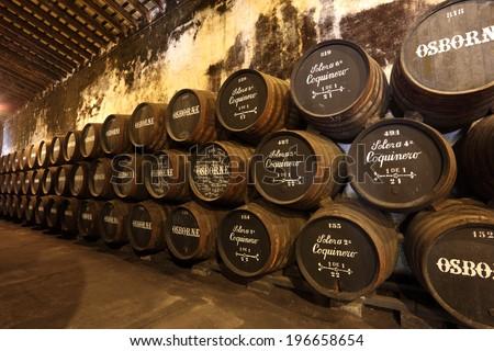 EL PUERTO DE SANTA MARIA, SPAIN - JULY 16: Wooden Wine Barrels at the Osborne Sherry Bodega. July 16th 2012 in El Puerto de Santa Maria, Andalusia Spain - stock photo
