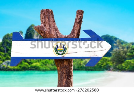 El Salvador Flag wooden sign with beach background - stock photo
