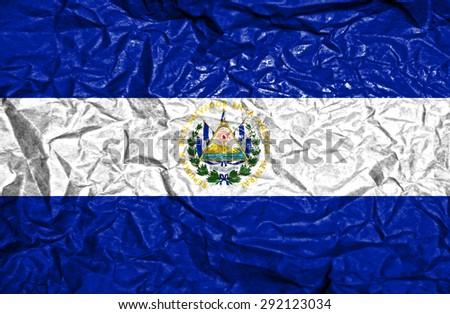 El Salvador vintage flag on old crumpled paper background - stock photo