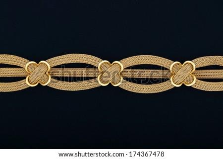 elaborate bracelet on dark blue felt - stock photo