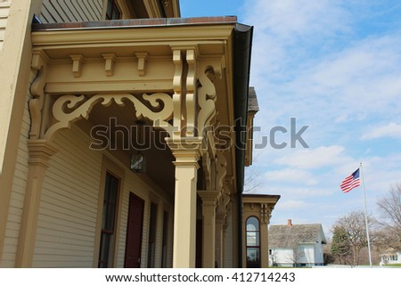 Elaborately carved and painted wood corbels support the overhang on a building. In architecture a corbel is designed to carry weight.