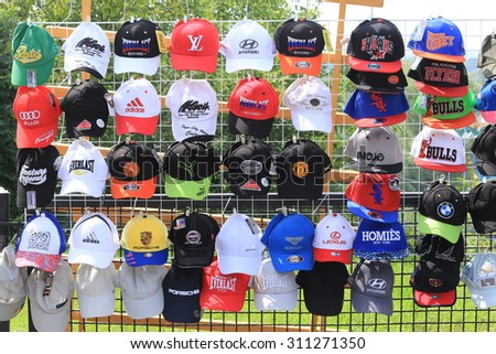 Elabuga, Russia - July 31, 2015: Annual Spasskaya Fair in Elabuga, shop with a variety of popular brands caps