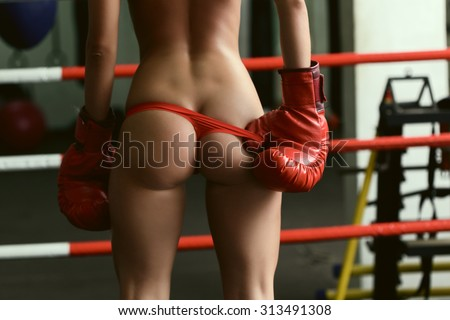 Elastic ass of sexy female boxer, close-up - stock photo