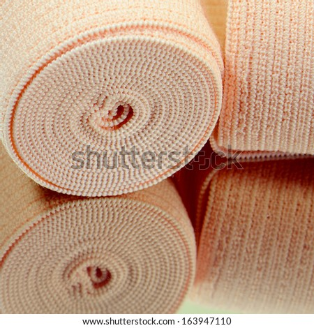 Elastic bandage roll for first aid. - stock photo