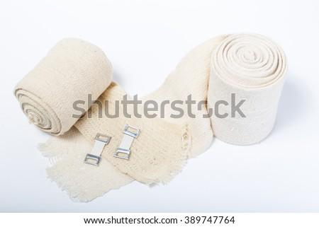 Elastic bandages on a white background - stock photo