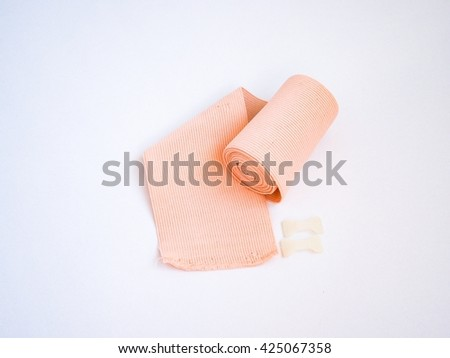 Elastic cotton bandage on white ground - stock photo