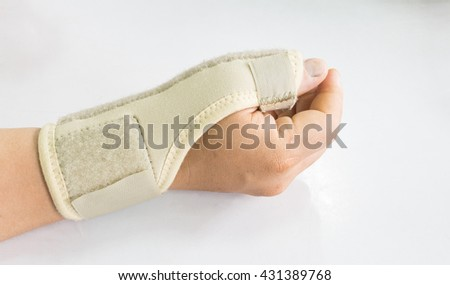 Elastic wrist support brace band wrap on hand to relieve pain, selective focus - stock photo