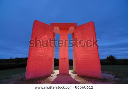 "ELBERT, GEORGIA - OCTOBER 12: The Georgia Guidestones, occasionally referred to as ""American Stonehenge"" October 12, 2011 in Elbert, GA. The inscription is of 10 principles in 8 different languages. - stock photo"