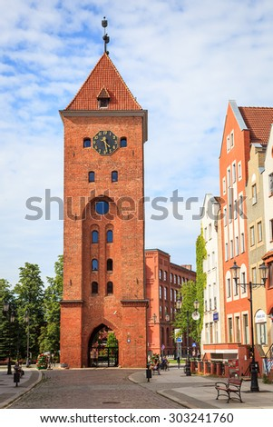 ELBLAG, POLAND - July 21, 2015: Market Gate (Brama Targowa) of Elblag is the only existing part of the city wall. The construction began in 1319 and it was enlarged to the current height in 1420-1430 - stock photo