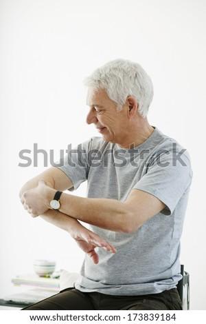 Elbow Pain In An Elderly Person - stock photo