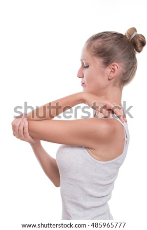 Elbow pain. Young woman holding her elbow, isolated on white background