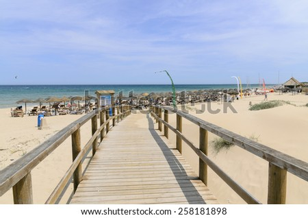 Elche, Spain - June 10 People enjoying on the beautiful beach of Arenales del Sol in a sunny day. Elche, Alicante June 10, 2013 - stock photo