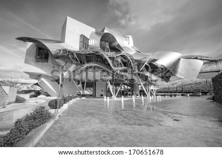 ELCIEGO, SPAIN - JANUARY 6: Winery of Marques de Riscal on January 6, 2014 in Elciego, Basque Country, Spain. This modern winery was designed by world famous architect Frank Gehry. - stock photo