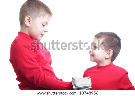 Elder boy giving bunch of fake money to younger