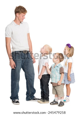 Elder brother with his younger brothers and sister isolated on white - stock photo