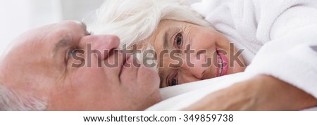 Elder lady is very happy with her husband