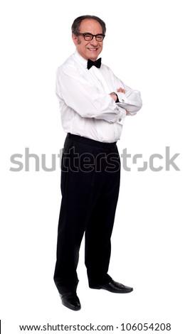 Elder man standing with hands crossed. Full length shot - stock photo