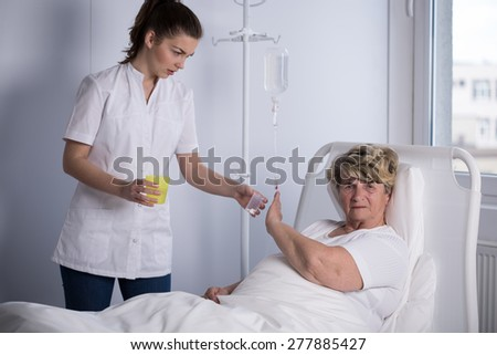Elder patient refusing to take a medicine