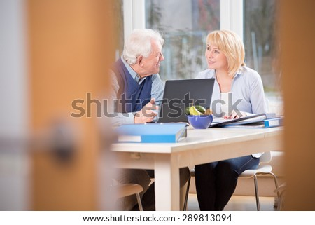 Elder people having conversation in their home office - stock photo