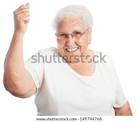 Elder woman celebrating something on a white background - stock photo