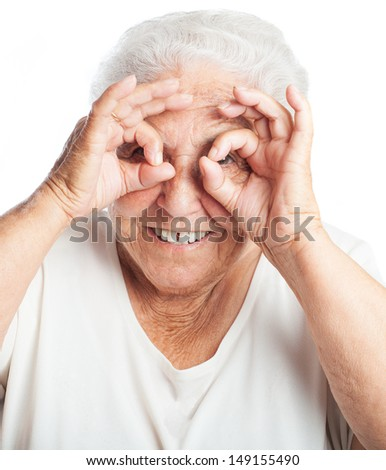 elder woman doing glasses grimace on a white background - stock photo