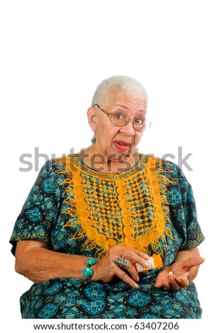 Elderly African American woman pouring her pills from a container into her hand - stock photo