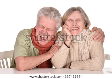 Elderly caucasian couple ill with influenza over a white background - stock photo
