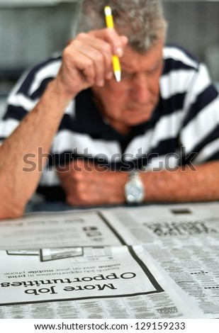 Elderly Caucasian Man Searching Classified Ads For Employment