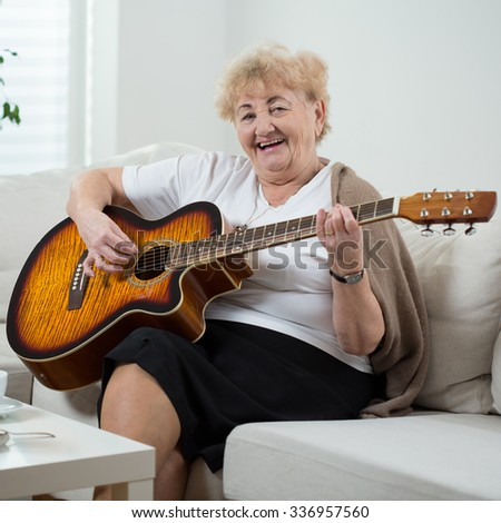 Elderly cheerful woman singing the song - stock photo