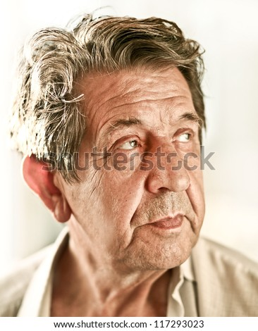 Elderly closeup sad man's face over white background