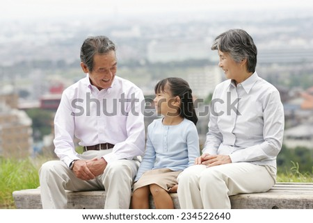 Elderly couple and their grandson - stock photo