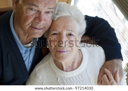 Elderly couple embracing - stock photo
