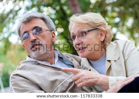 Elderly couple enjoying outdoor - stock photo