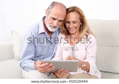 elderly couple in internet - stock photo