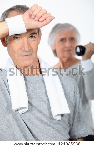 Elderly couple in the gym - stock photo