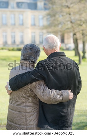elderly couple looking at a building