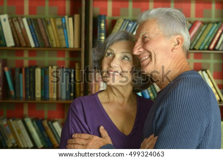 Elderly couple over book shelves