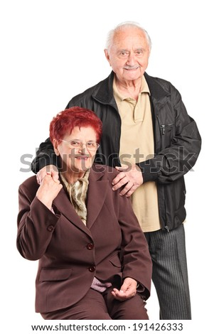 Elderly couple posing together isolated on white background