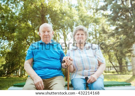 Elderly couple relaxing in the park,