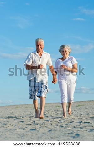 Elderly couple relaxing on a sunny day together - stock photo