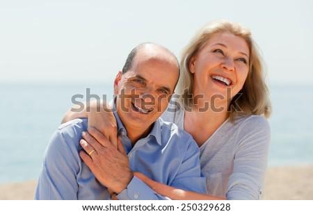 elderly couple spends time on beach - stock photo