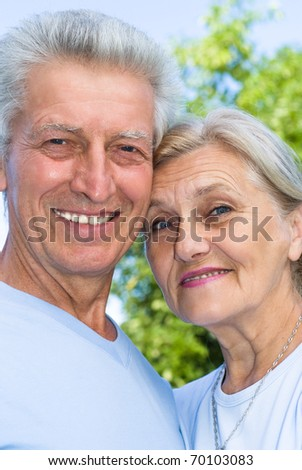 elderly couple together in a summer park