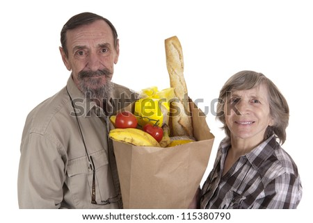 elderly couple with a paper bag of groceries