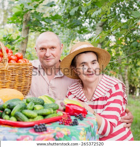 elderly couple with vegetables outdoor - stock photo