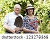 elderly couple working in urban garden - stock photo